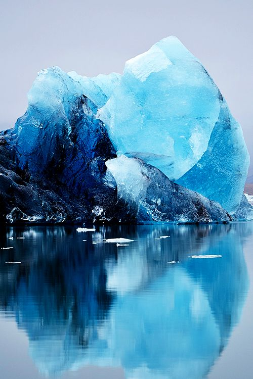 The icebergs of Iceland comes in many different colors, shades and sizes. This one is big, blue and beautiful, but you can also see striped icebergs like zebras, milky whites, and crystal clear shapes like giant ice cubes laying on black beaches. Make sure to see our range of ice, when you visit on vacation - and of course our stunning glaciers.
