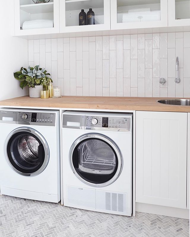 Laundry lovin   Washer and dryer @fisherpaykelau | Herringbone floor tiles and vertical subways @ambertiles | Tap @caromaaustralia | Round sink #clarke | Cabinetry @carrerabydesign | Timber bench #bunnings | Flowers @fauxflowercompany #thehillsarealivewithrenofive