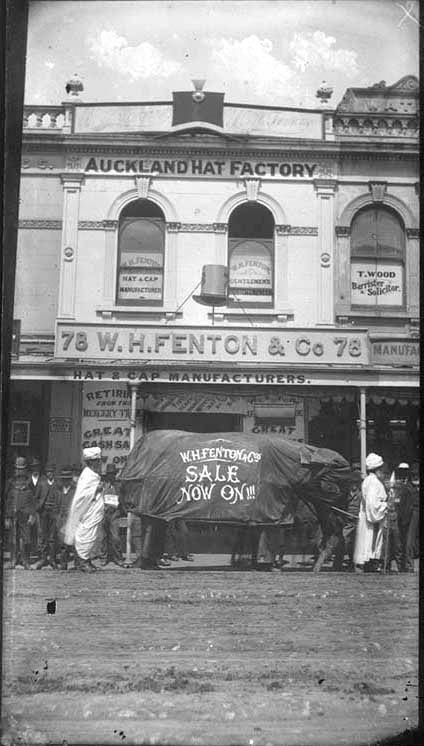 Showing the shop frontage and sale advertisements for a hat manufacturer at 78 Queen St.  Sir George Grey Special Collections, Auckland Libraries, 4 -RIC118