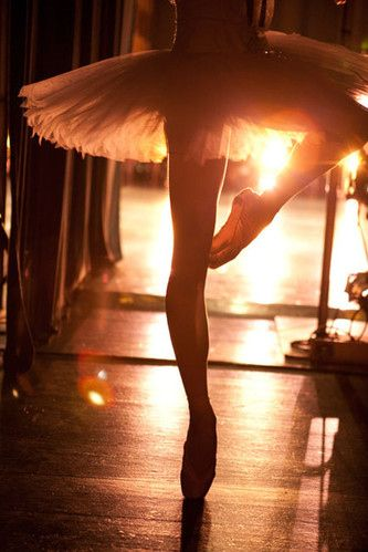 I like the way the stage lights are shining through her dance passe, it bathes the area in an artificial light that contrasts against the darkness of backstage. The photo enables you to feel the anticipation of going on stage.      (AMARIS)