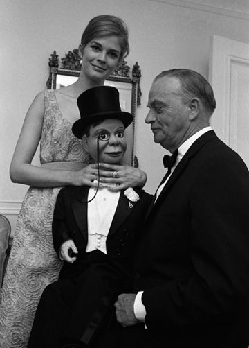 Candice Bergen strangles Charlie McCarthy, the puppet used by her father, the celebrated ventriloquist Edgar Bergen, 1966.