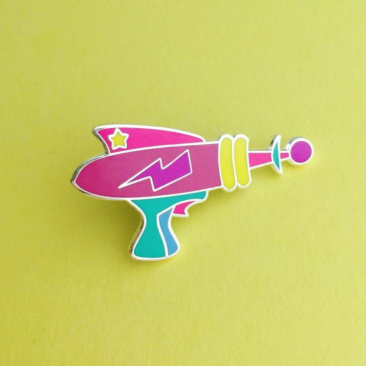 Rainbow Laser Gun Enamel Pin Badge - Retro Ray Gun Lapel Pin by fairycakes on Etsy https://www.etsy.com/listing/463852436/rainbow-laser-gun-enamel-pin-badge-retro