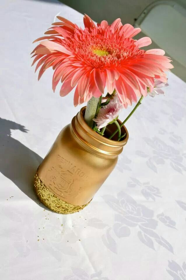 Not a cake buuuut glittered mason jar I made up as centrepieces for the tables at the party :)