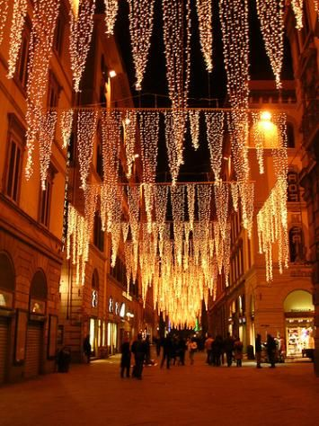 Florence - Italy - Every street has different Christmas lights hanging above the whole street. This street was my favorite. I miss Christmas in Florence.