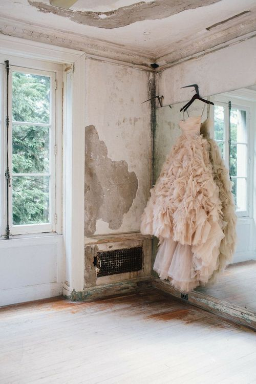 Antiqued walls, French doors, crown moldings, ruffled ball-gown