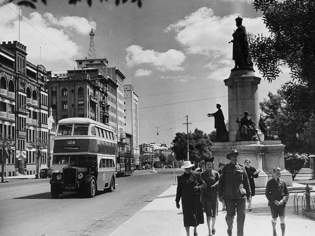 A double-decker bus travels along North Tce in the 1950s.