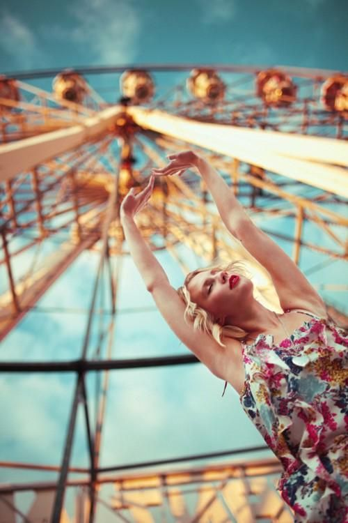 Cool perspective in front of a Ferris Wheel for fair/carnival photography.