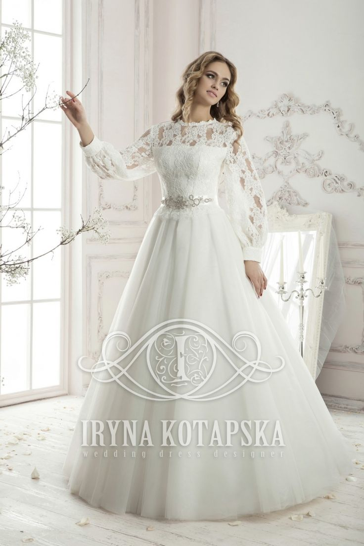 BB1371 in store now:Elegant designer gown by European Bridal Label 'Iryna Kotapska'. Beautiful lace bodice with scoop neck, long sleeves and buttons on the back. Complemented with a stylish beaded belt. Tulle A-line skirt.