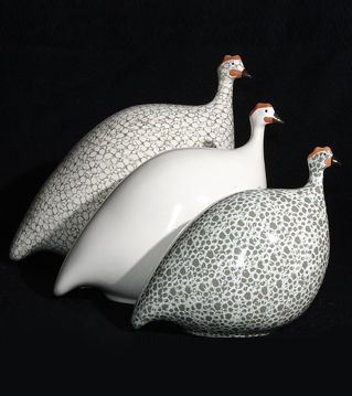Fowl Play in Elle Decor Provence company handcrafted guinea fowl - range of colours to go with any decor.  Expensive ...look on ebay?