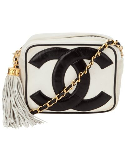 White leather vintage bag from Chanel featuring double C in black,   top zip, gold tone chain strap interwoven with black leather and a white leather tassel with gold tone hardware. Please note that vintage items are not new but often between 20 and 50 years old, and therefore will always have minor imperfections, even when the items have been used and worn with love and care.