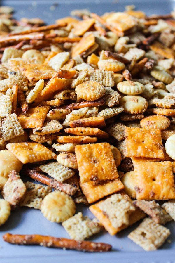 Looking for the perfect snack recipe? This cheesy chex mix is made with brown butter and bakes to perfection in no time. Make it as a lunch snack or pre party treat. Everyone will love it!