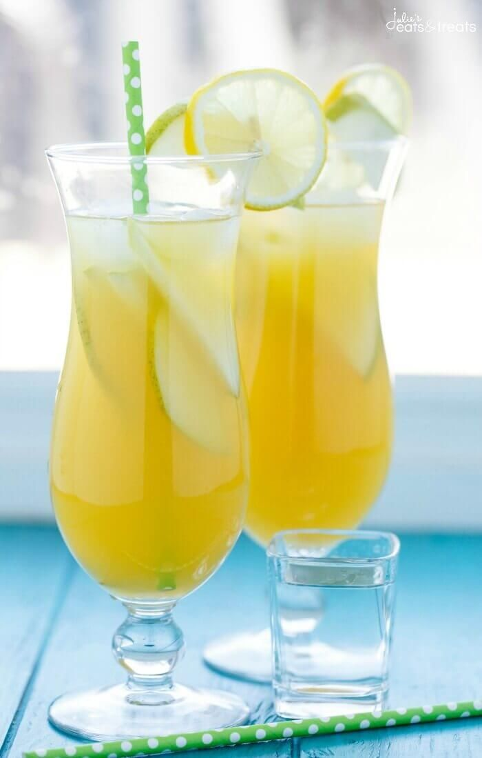 Pineapple Fruit Cocktail Drink Recipe ~ A blend of pineapple, apple, and orange juice are the stars of the show with this pineapple fruit cocktail. Served with sliced pear and the optional rum which are also refreshing for the summer! ~ http://www.julieseatsandtreats.com