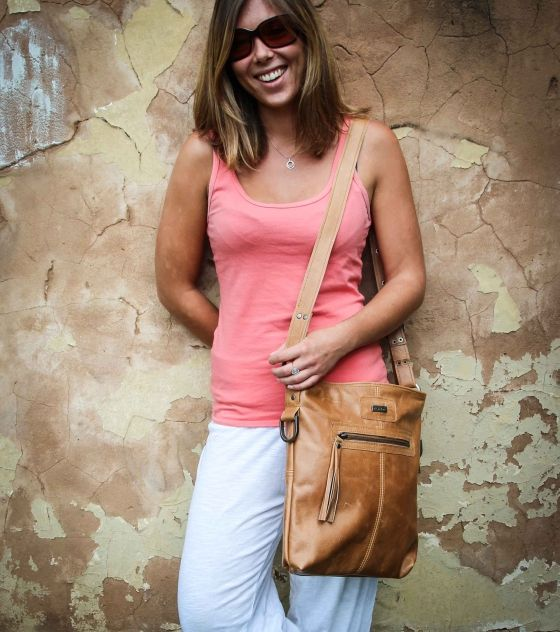 Gorgeous, practical Thandana Messenger Handbag made from genuine bovine leather in hazelnut color with contrast stitching. Shop @ www.wave2africa.com