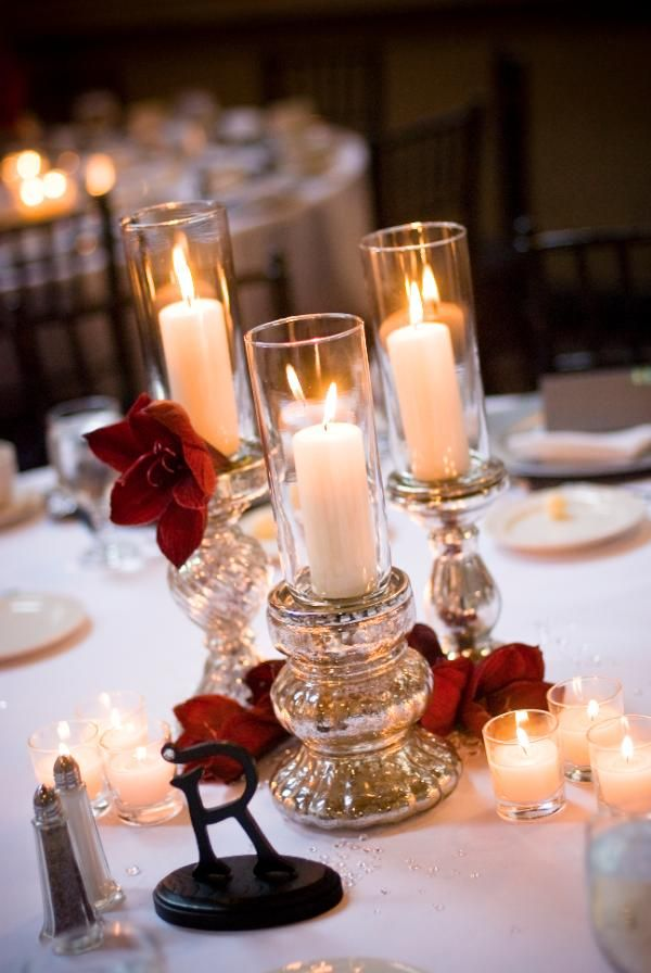 The Sacramento Grand Ballroom, located in Sacramento, CA. Centerpieces with mercury glass candlesticks and red amaryllis blooms.