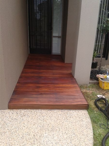 light oak decking oil on Merbau decking landing by front door which had been sanded back to show the grain of the timber.
