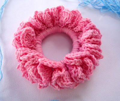 Crocheted scrunchie. I'm going to make this in white for the temple. Maybe mix it with some yarn that sparkles - just as long as it's white.