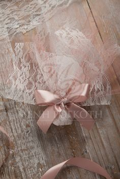 Classic tulle and lace wedding favor bomboniere in vintage colours