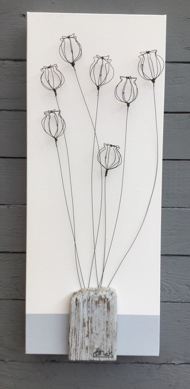 Hand formed 3D wire poppy heads with driftwood