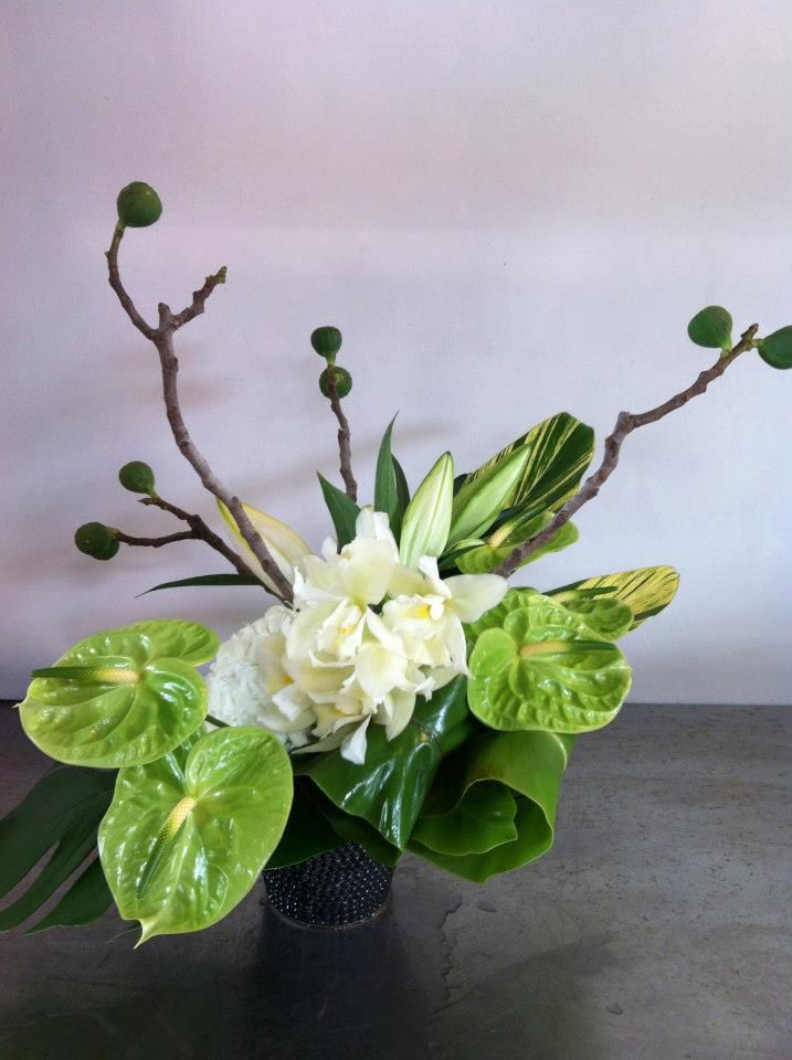Stylish Floral Arrangement With Fresh Fig Branches Green Midori Anthirium And Ti Leaves