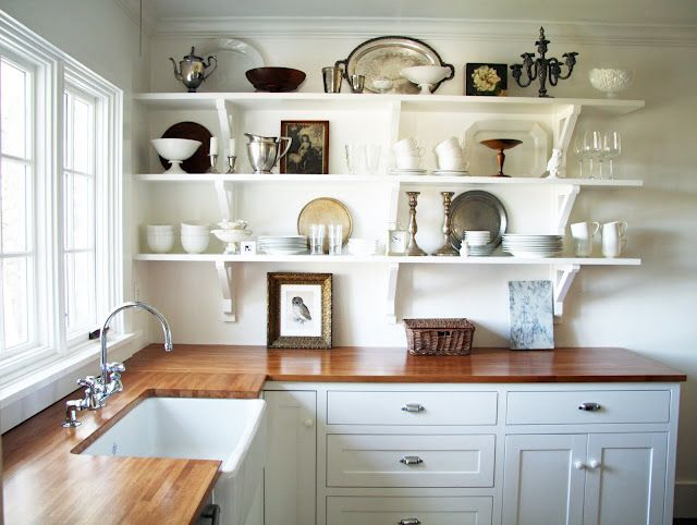Belfast sink, white shelves, beautiful display of objects, wooden counters. Wowzer.