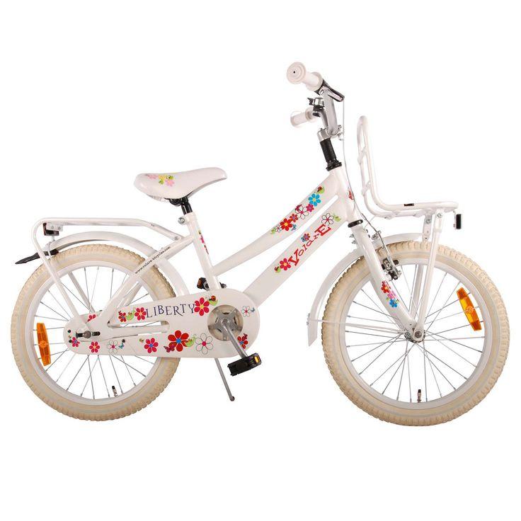 """Volare Kinderfiets Liberty Urban Flowerie 18"""" wit  Description: De Volare Liberty Urban Flowerie 18 inch wit is een mooie transportfiets voor meisjes in de leeftijdsklasse van 5 tot 7 jaar. De Liberty Urban heeft een opvallend stalen oversized frame en zorgt dat de fiets stevig is en tegen een stootje kan. De terugtraprem in het achterwiel en de knijprem op het voorwiel zorgen ervoor dat je kind veilig kan remmen en tot stilstand kan komen. Op de voordrager en bagagedrager achter neem je…"""