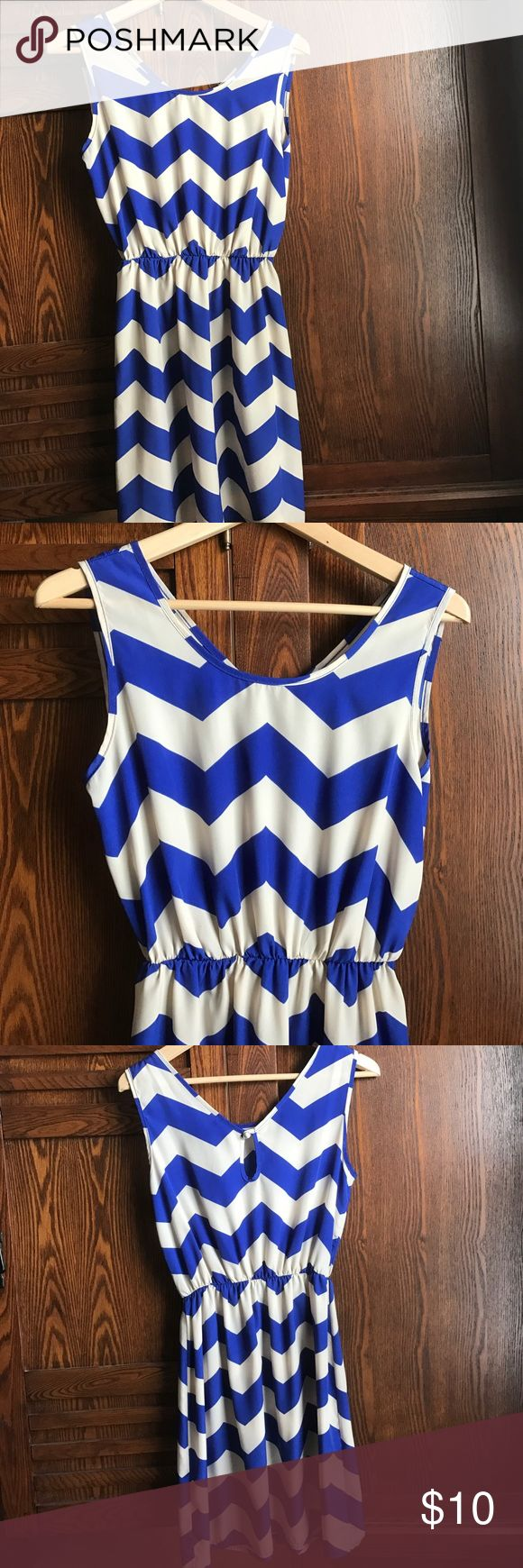 Chevron dress Fun, royal blue chevron dress. Length is just above the knee (but I'm short). Unlined, with a small key hole in the back. Dresses