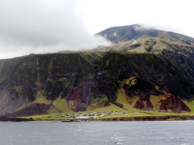 10 of the Most Remote Places on Earth Where People Actually Live. Tristan da Cunha has the title of being the world's remotest inhabited island. It's home to around 270 people, who are all farmers and who all live in the 8-mile long, 38-square-mile island's single settlement, Edinburgh of the Seven Seas. The island was first discovered in 1506 by the Portuguese sailor it's named for. It's 1,750 miles from South Africa, and 2,088 miles from South America.
