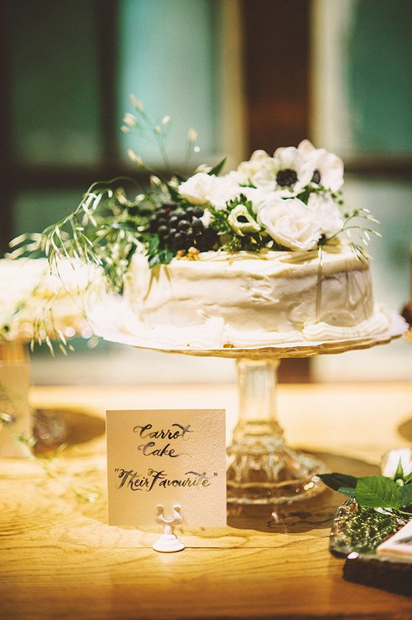 simple flower topped cake, photo by Kim Smith-Miller http://ruffledblog.com/seattle-wedding-with-vintage-glam-flair #weddingcake #cakes