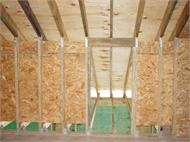 Keewall in the attic is reinforced with OSB sheathing to resist shear (racking wind loads) and hurricane connectors to resist uplift.