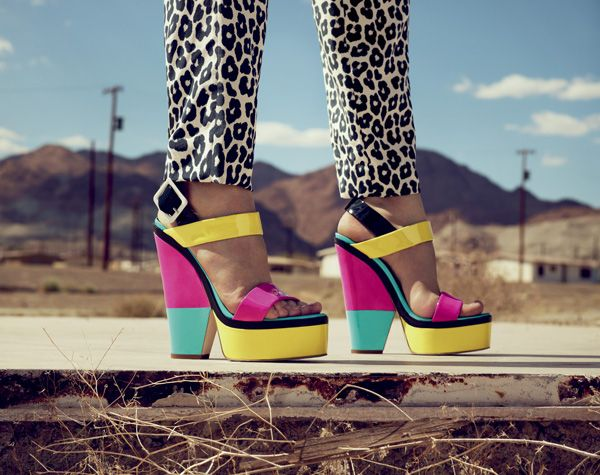 Giuseppe Zanotti Colorblock demi-wedge platform sandals in fluorescent yellow/pink/turquoise patent leather with black trim.