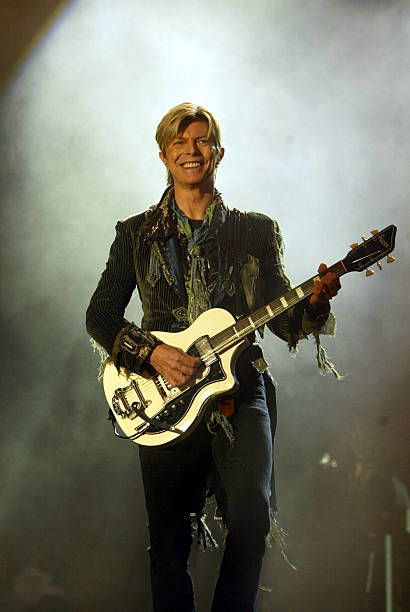 Singer David Bowie performs on stage during the third and final day of 'The Nokia Isle of Wight Festival 2004' at Seaclose Park on June 13, 2004 in Newport, Isle of Wight, UK. The third annual rock festival takes place during the Isle of Wight Festival which runs from June 4-19.