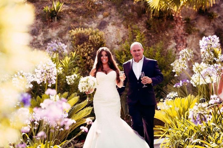Walking into the ceremony with my dad! Wearing a Maggie sottero design . Lace fishtail wedding dress #lace #fishtail #wedding