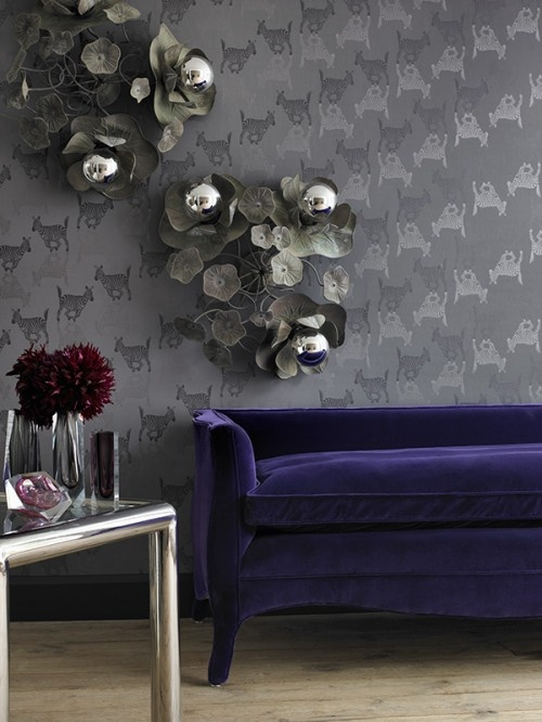 The flower sculptures on the wall are great! The rest can be trashed (this: decor for a goth with money;).