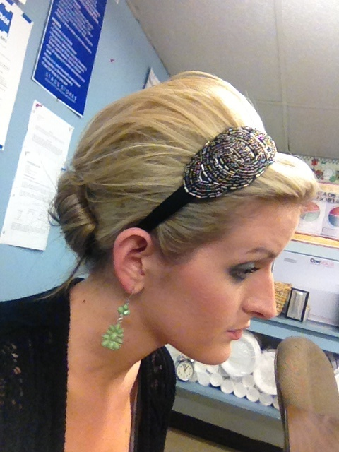 Updo with headband:)  But maybe not so poofy...