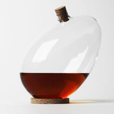 Sebastian Bergne says bottoms up with tilting egg-shaped decanter Product Design #productdesign   Glass!   Decanter, London design festival, Wine carafe