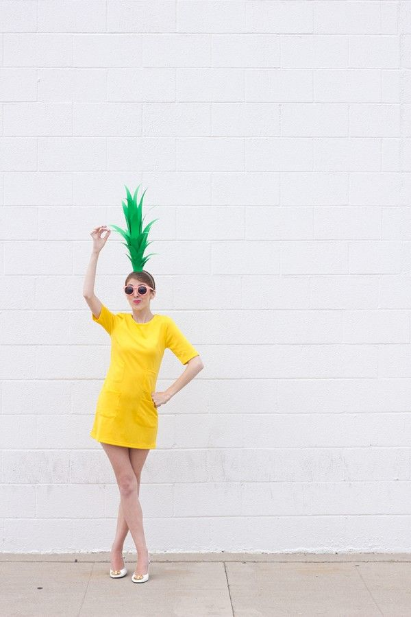 This is toooo weird. I was cutting a pineapple today and thought... hmm that would be a cute costume... and then I see this on Pinterest! Crazy. Pineapple Costume DIY