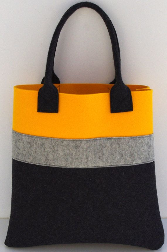 Wonderful tote, perfect for shopping or to fit everyday belongings in. I combined the bright yellow with charcoal and added light grey to give it a more sophisticated look. Measurements: 35cm/ 14 x 35cm/ 14 x 8/ 3    Fabric: yellow and charcoal wool felt 3mm, light grey wool felt 1.5mm    Please contact me, if you have any questions.    I ship via normal post from France. Should you wish a tracked or express delivery, please contact me and I will arrange that for you. Please check my…
