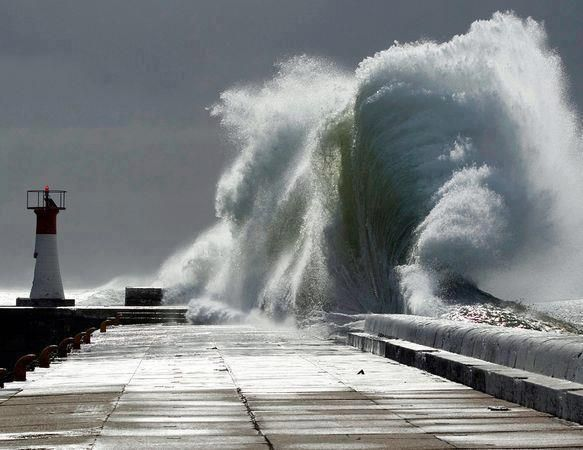 This photo shows a enormously huge wave crashes in Cape town, South Africa during a storm. Description from whatthehellnews.com. I searched for this on bing.com/images