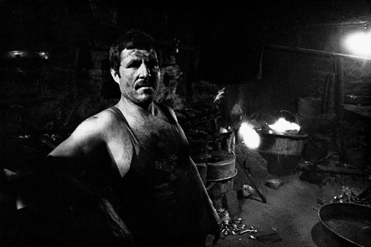 Ara Guler TURKEY. 1988. Iron worker at the repair wharf.