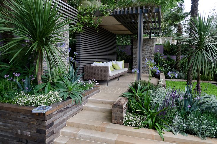 Recycled timber retaining wall at the Chelsea Flower Show. Pinned to Garden Design by Darin Bradbury.