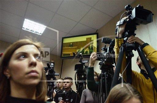 On 11/25/2016 Journalists in Kiev's Svyatoshinsky district court watch a video streaming from the Rostov Region Court where former president of Ukraine Viktor Yanukovych arrived to testify on the 2014 riots in Kiev. (Stringer/Sputnik via AP