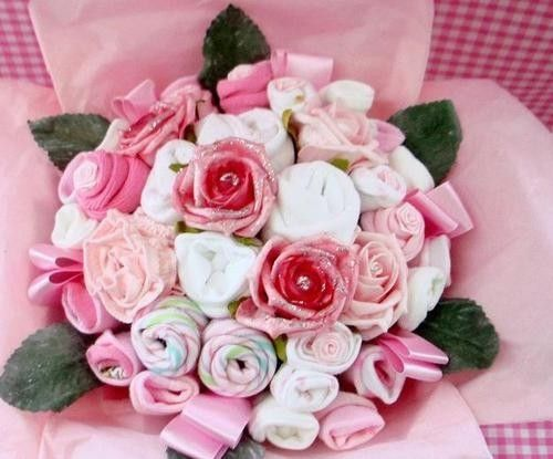 Bouquet of baby clothes - lovely idea for a homemade gift.