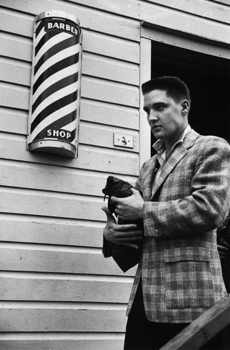 Fort Chaffee, AR, March 25, 1958: Elvis is photographed leaving the barbershop after getting his Army haircut from James 'Pete' Peterson, supervisor of the barbers.