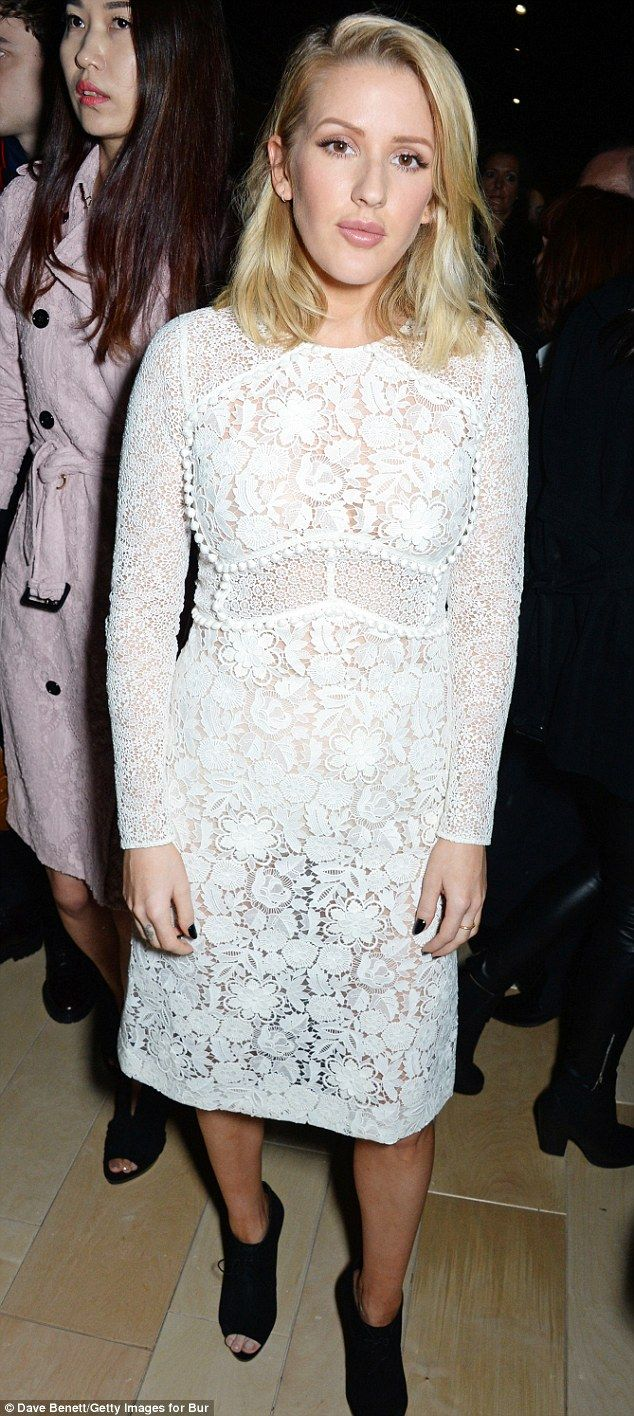 Ellie Goulding gave onlookers a glimpse of her curves in the semi-sheer white lace number ...