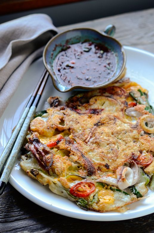 "There are several savory Korean pancakes that many people like to order at Korean restaurants, and perhaps this ""seafood green onion pancake"" has to be the most popular one. We call it Hamul-pajeon (해물파전)."