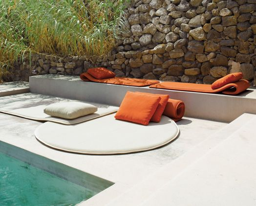 Nice simple design that invites. The rock wall flanking the clean lines of the pool gives off a really nice look.