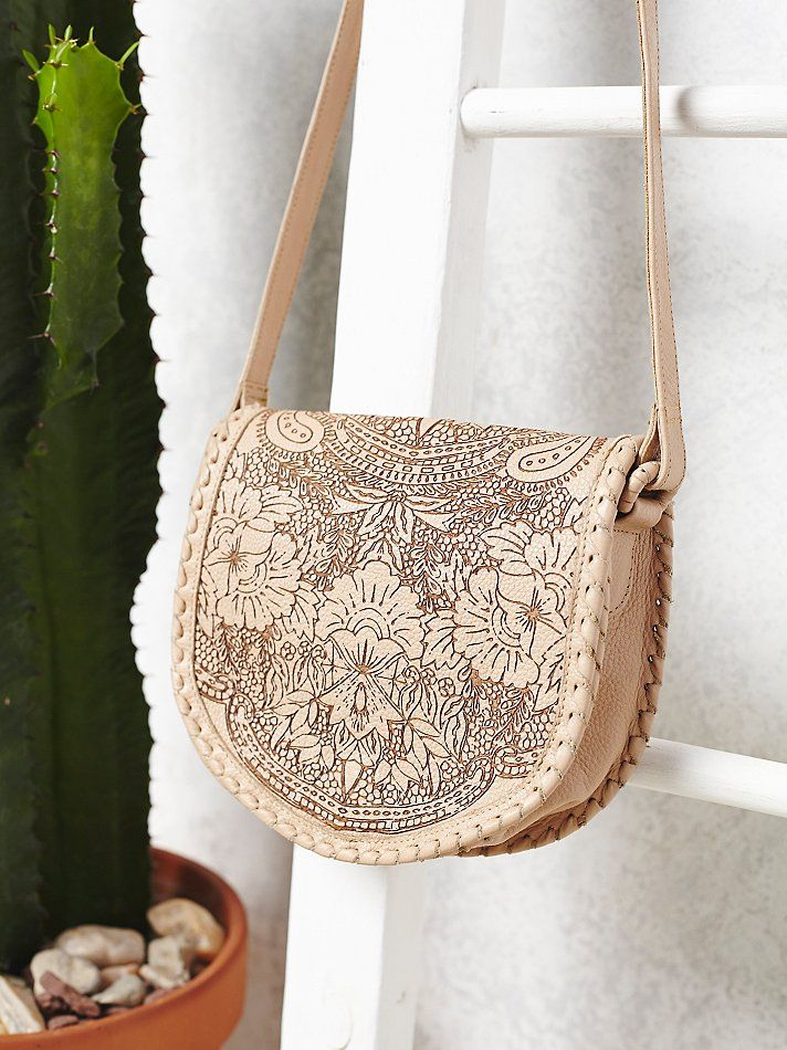 Cleobella Santa Anna Crossbody leather saddle bag featuring a floral etched design $198 | Free People