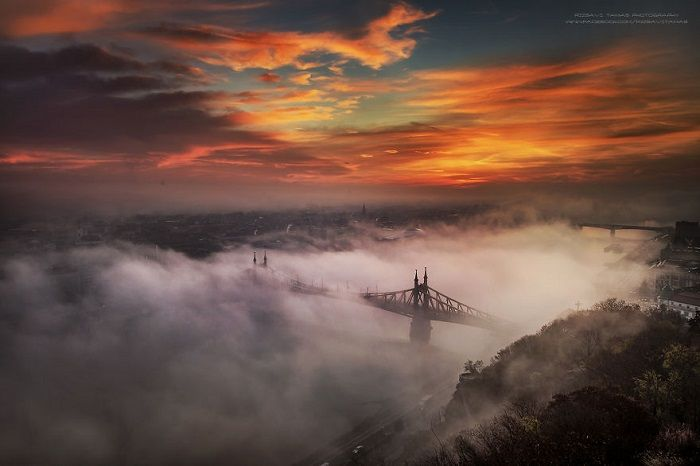Tamás Rizsavi has been mounting Budapest's most important buildings, towers, monuments and everything almost 6 years. He will to shoot the right photos about his town. Real love and passion! He even risk his life to need photos of his town in unrepeatable lights and unbelievable heights. He try to take photos in several lights…
