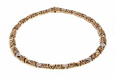 COLLIER  Gold. 14 K.  Executive with 25 brilliants 0.25 ct,  Total weight: 35.7 gr.  Estimated quality: Wesselton SI to Pique 2  HEIGHT 9 MM