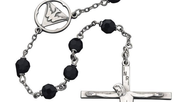 No buyer for JFK's rosary beads in NY sale.